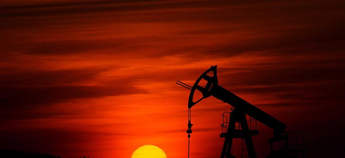 oil rig and sunset representing saudi arabia oil attacks 09.2019