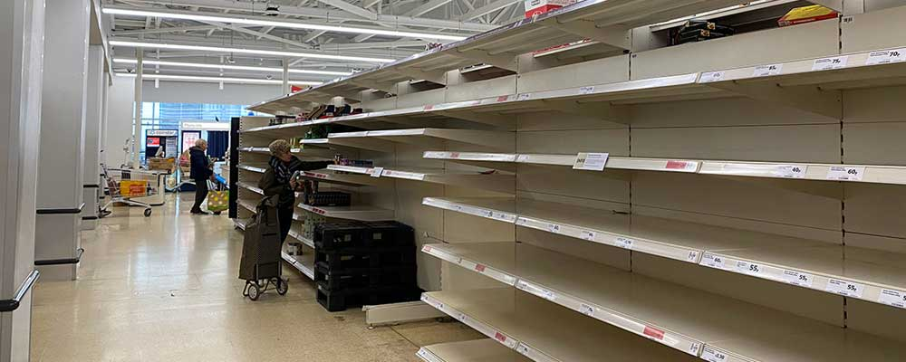 Empty shelves in London branch of Sainsburys