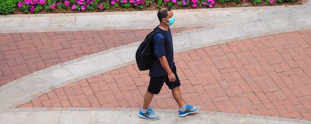 Lone man with mask representing Coronavirus distancing