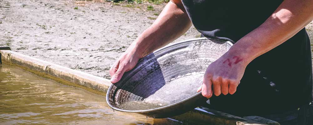 person panning for gold