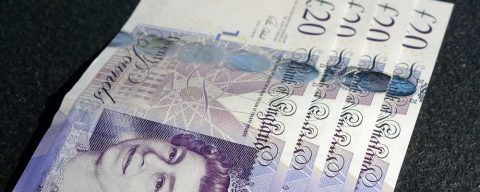 £20 notes lying on table to depict UK pension transfer values