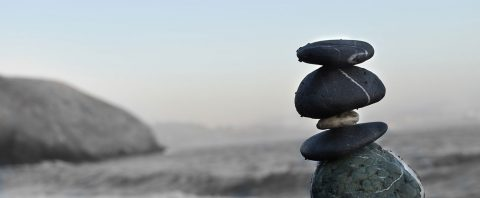 Stones balanced on top of each other representing balance in the post